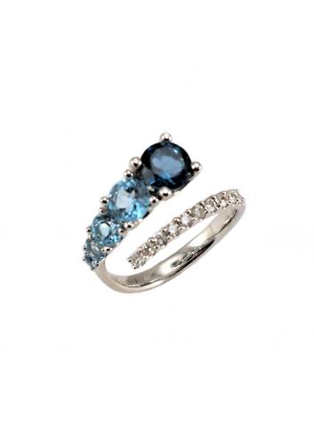 anillo de oro blanco con diamantes y topacios azules